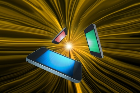 Three blank telecommunication devices with illuminated screens in a variety of colours giving the appearance of moving towards the centre of a golden motion zoom effect against a black background. Stock Photo - 10983064