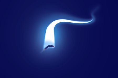 Close up on an ignited candle wick with extended blue flame against a blue background. Stock Photo - 11103969