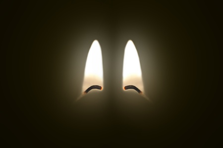 Close up on two ignited candle wicks against a black background. Stock Photo - 11103968