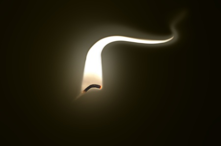 Close up on an ignited candle wick with extended flame against a black background. Stock Photo - 11103964