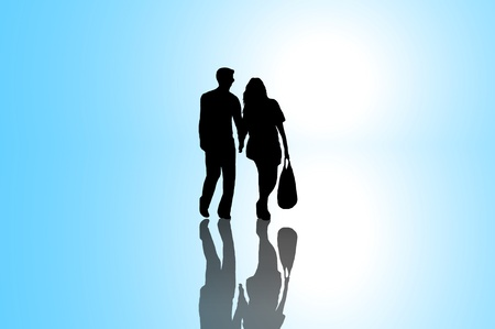 bright future: A silhouetted young couple walking on reflective surface towards a bright light with blue background.