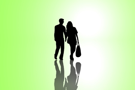A silhouetted young couple walking on reflective surface towards a bright light with green background.  photo