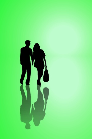 sillhouette: A silhouetted young couple walking on reflective surface towards a bright light with green background. Stock Photo