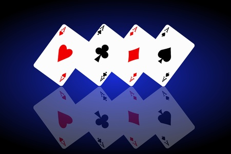 Illustrated four ace cards standing in formation on their corners and reflecting into foreground. Black and blue background. photo