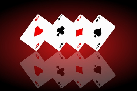 Illustrated four ace cards standing in formation on their corners and reflecting into foreground. Black and red background. photo