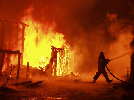 damaged house: Firefighter