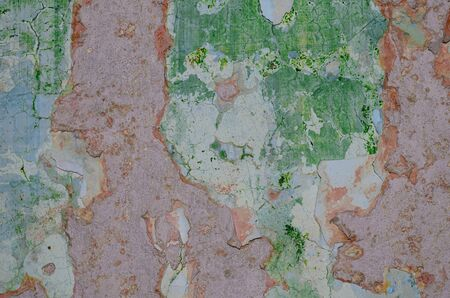 background consisting of old layers of plaster of different colors Stock Photo