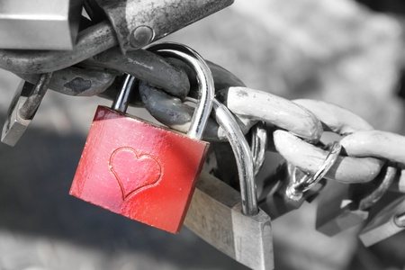 Red padlock with an engraved heart photo