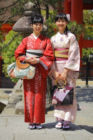 Smiling asian women wearing kimono dresses photo