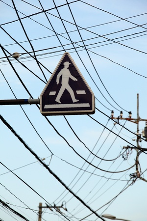 Pedestrian road sign between confusion of cables Stock Photo - 21584172