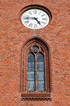 Historic german brick facade with nostalgic clock photo