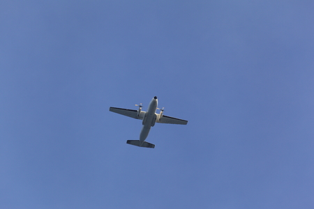 Flyover propeller airplane at the blue sky photo