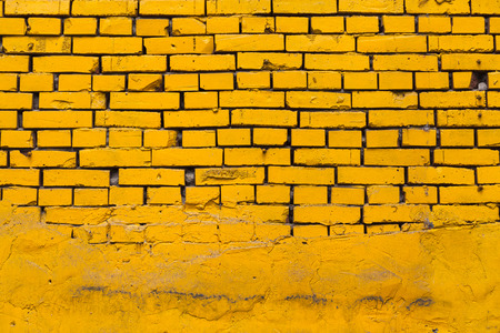 powerful creativity: Vintage yellow brick wall partly facing with concrete