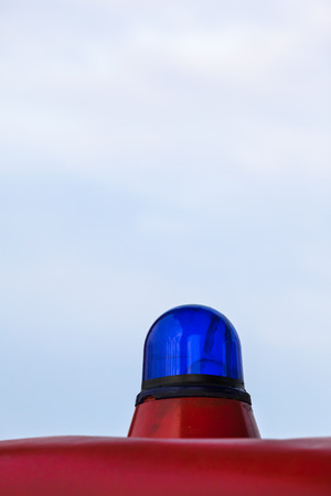 Vintage blue light bulb at a red car roof photo