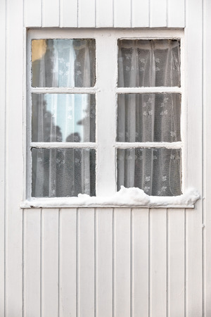 transom: Vintage transom window at a white wooden wall in winter