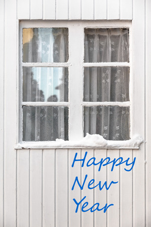 transom: New year greetings with vintage transom window at a white wooden wall in winter