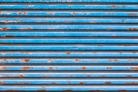 Detail of rusty vintage blue roller shutter photo