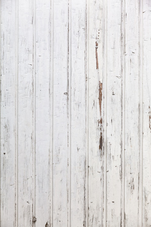 Vertical white wooden paneled shabby chic wall