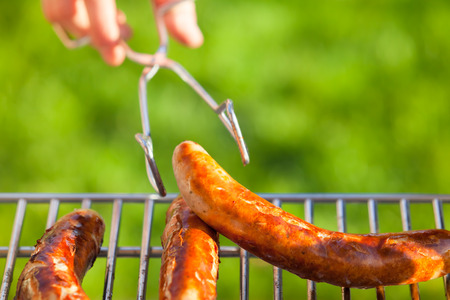 tongs: Hand hold tongs for food with at barbecue grill