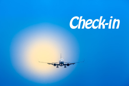 textual: Blue sky and blurred yellow light with an airplane on landing approach in front of it with textual message