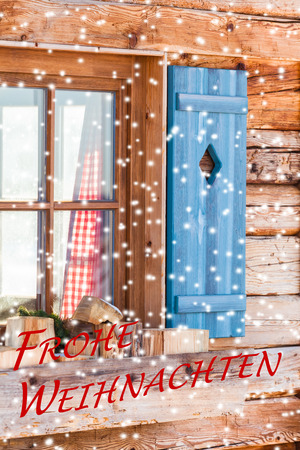 mountain hut: Snowy window detail of a bavarian alps wooden mountain hut with textual holiday message