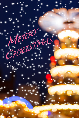 Defocused soft lights background of nostalgic christmas holiday fairground in the snow and textual wishing