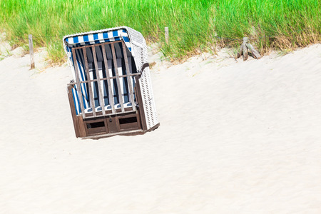 cushioned: Single cushioned beach chair at a sandy dune of german coast at the baltic sea