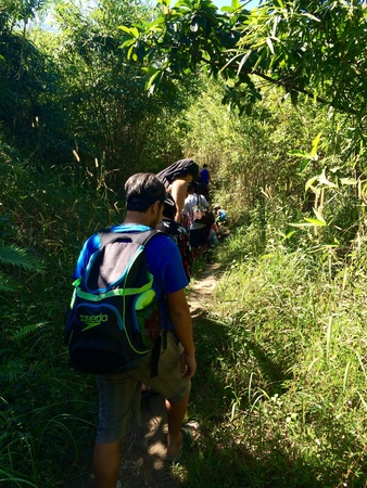 sunburned: A group of friends is enduring the heat of the sun in their hiking. Stock Photo