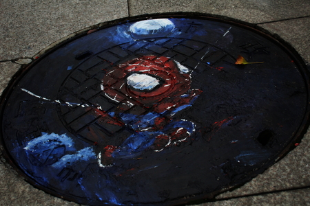Spiderman drawing on manhole cover