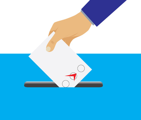 Hand putting voting paper in the ballot box. Voting. Election.