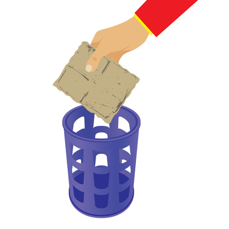 Hand throwing trash in the waste basket. Rubbish bin.