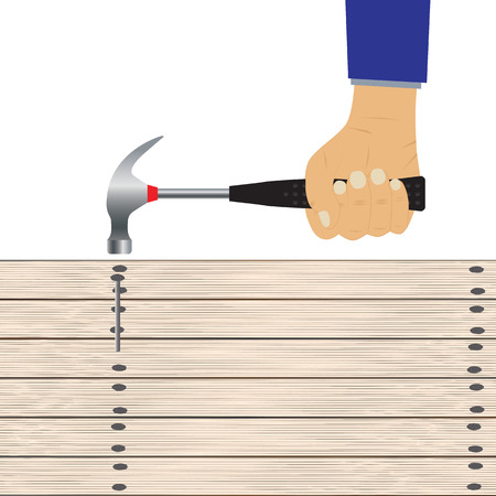 Hand with a hammer and wooden board.