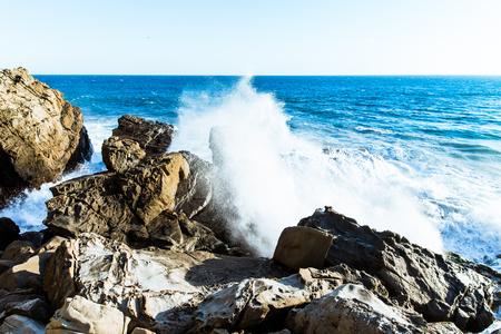 big waves: Big waves crashing against rocks