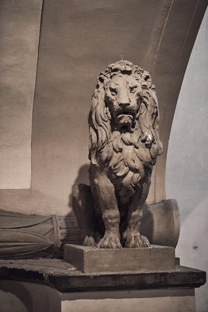Italian lion medieval sculpture staying on set in Florence Stock fotó