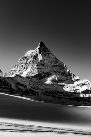 Aerial view of winter switzerland Mountains and Matterhorn landscape in black and white.