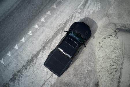 big black matt American pickup truck staying after drifting on the asphalt with tire marks Reklamní fotografie