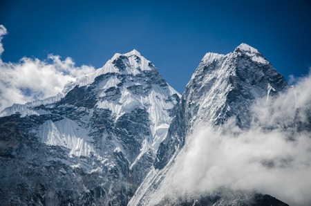 Close look of Ama Dablams summit from trek to Everset  in a sunny day from the village nearby. Stock Photo