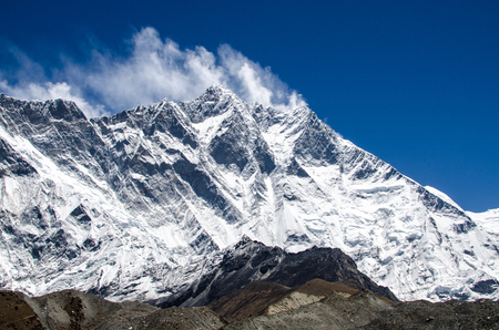Front view of south face wall of Lhotze mountain in Nepal. Hymalayas.  8516 meters above the sea. with clouds above it. at sunny day. Stock Photo