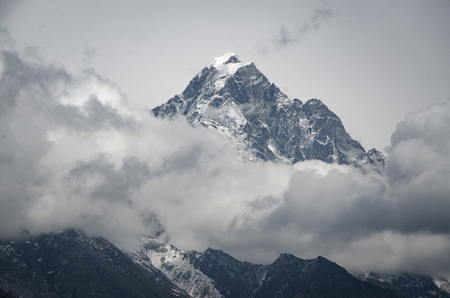 panoramic beautiful view of Ama Dablam covered by clouds from trek to Everset in  contrast view.