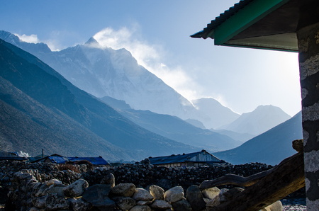 Front view of south face wall of Lhotze mountain in Nepal. Hymalayas.  8516 meters above the sea. with clouds above it. at early morning from Everest trek.