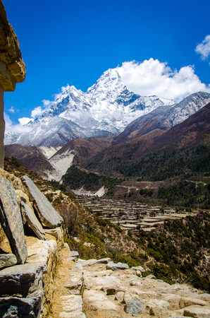 beautiful view of Ama Dablam from trek to Everset and a clouds in a sunny day near the summit.