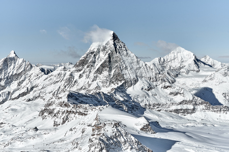 great view of Matterhorn East face in a bright winter day with a good weather with a little bit clouds nearby