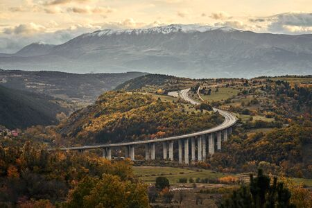 Curving alpine road in the mountains of Italy.