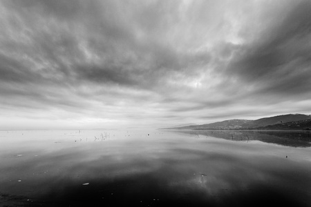landscape with frozen lake and black clouds photo