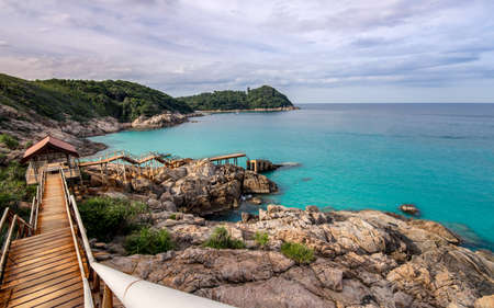 Concrete stairs and walk way leading down to the broken pier in an paradise empty bay on Perhentian Kecil, Malaysia.