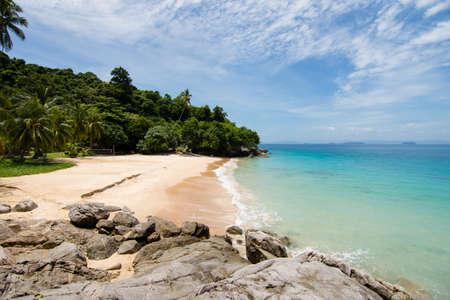 Light waves of idilic turquoise sea meets small sheltered golden sand beach on a paradise island. perhentian islands, Malaysia. Stock Photo