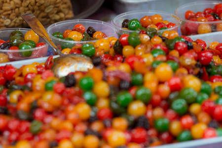 affordable: Pickled glazed fruits for sale at Asian market.