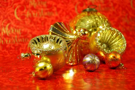 Christmas decoration in gold colors on red background