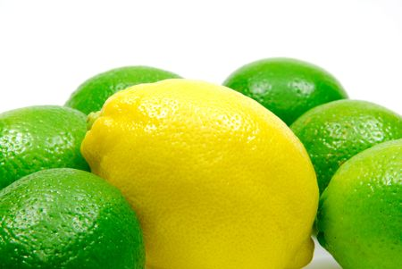 Yellow lemon surrounded with green limes