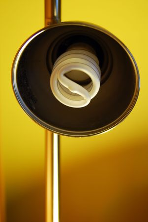 A part of a self standing lamp isolated on yellow background.Light bulb turned Off
